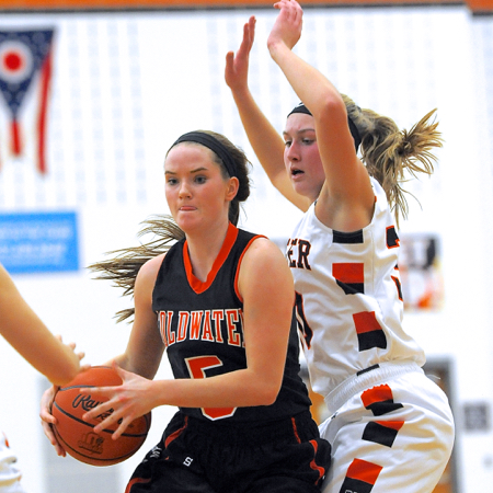 Minster's defense surrounds Coldwater's Olivia Harlamert.