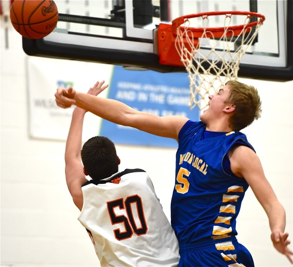 Tough inside...Marion's Nathan Bruns only scored 7 points, but denied Jarod Schulze 2 of his own with this fourth quarter block.