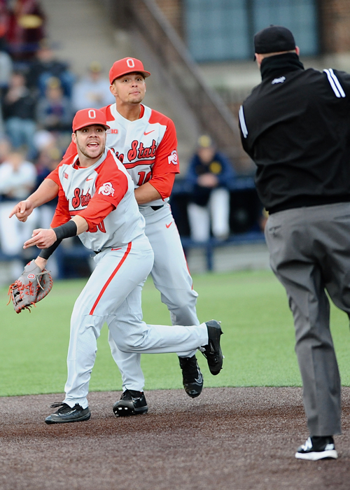 First baseman Bo Coolen and pitcher Jake Post find fault with a call by the first umpire in the sixth inning.