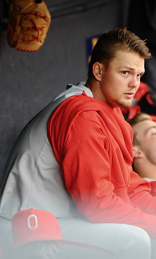 Jake Post peers hopefully at the scoreboard during the Buckeyes' rally in the eighth.