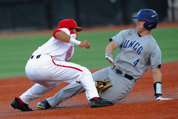 Second baseman Noah West knocks off UNCG's Andrew Moritz on a steal attempt of second base.