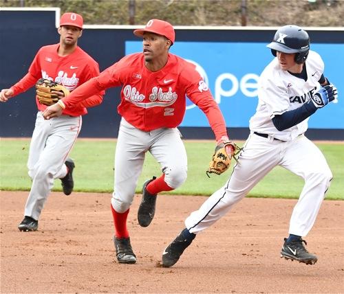 Jalen Washington chases down Xavier shortstop Mitch Gallagher.