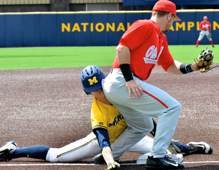 Brady Cherry's tag attempt is late to retire Michigan's Jimmy Kerr.