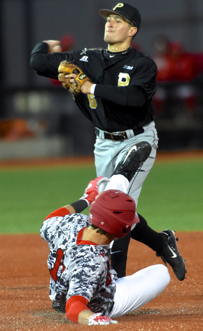 Shea Murray does his best to break up a double play attempt by Purdue's Harry Shipley.