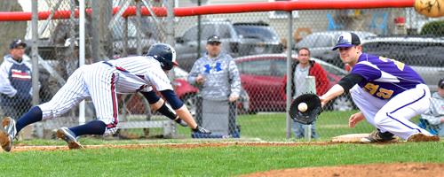 Butler's Dolen Fultz tags out a Piqua runner at first  between pitches.
