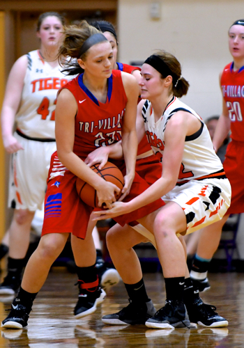 A jump ball is called after these two struggle to get the ball in their own possession.