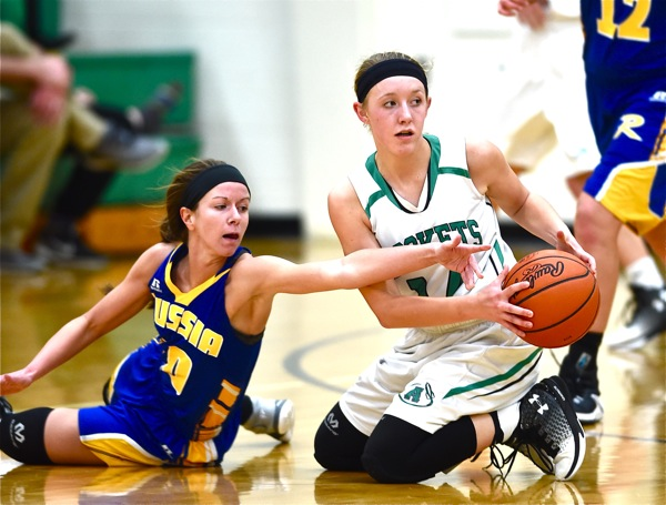 Second half defense was better...Russia's Tiffany Hatcher challenges Anna's Breah Kuck for a loose ball.