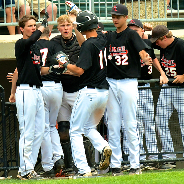 Carter Siegel (#11 ) is greeted by his teammates after his 2nd hit & run of the game.