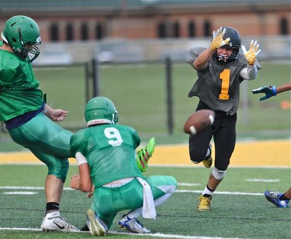 Sidney's Conor Beer (#1) was a step short on his block attempt of an extra point.