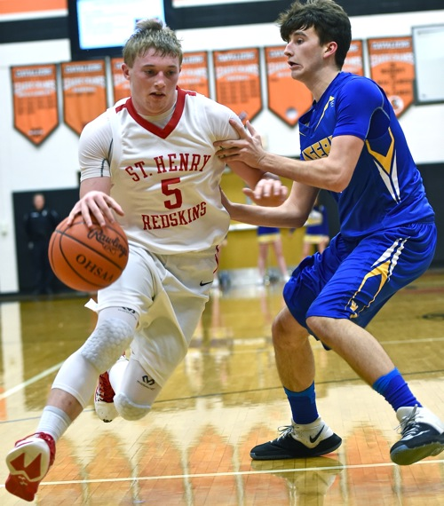 Tyler Schlarman scoots past a Goshen defender and to the rim for two of his 13 points.