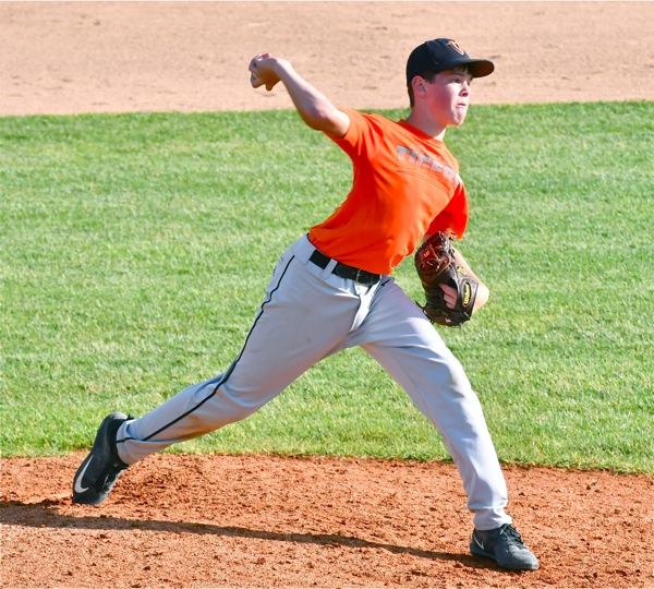Following in Stammen's steps, a Versailles pitcher works in Friday's win over Minster.