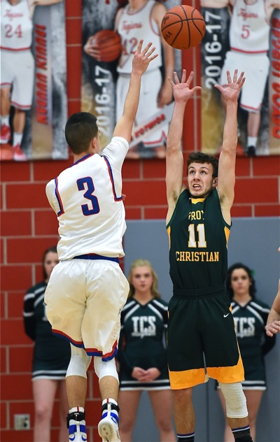 Hands Up, Don't Shoot...but the Patriots' Dillon McCullough let fly, anyway, over TC's Seth Wynne.