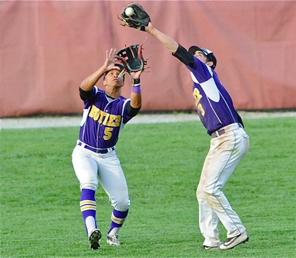 Butler shortstop Damon Dues reaches in front of teammate Henry Barwick to make a catch in the seventh inning.