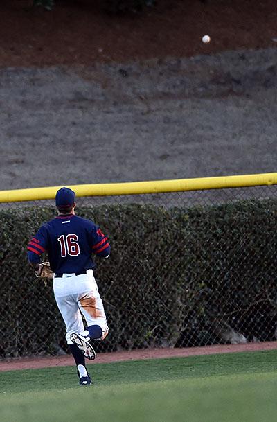 Left fielder Mitch Coughlin watches the eighth inning home run by Furman first baseman Brandon Elmy.