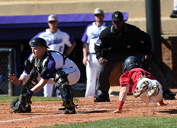 Nick Ryan lunges for home plate to score one of the Flyers' six runs in the fourth.