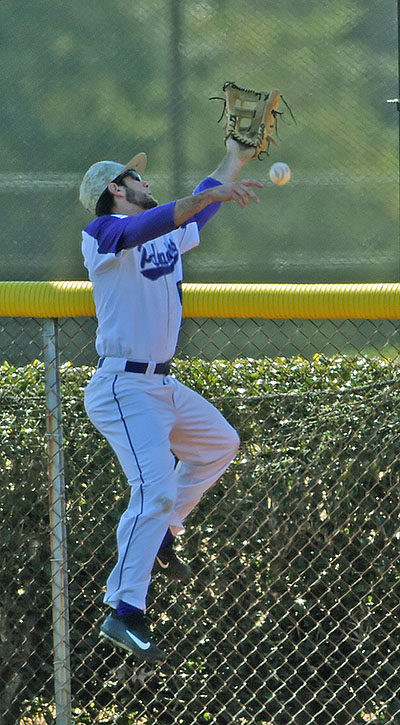 Furman right fielder Dave Webel narrowly misses catching Mitch Coughlin's second inning.