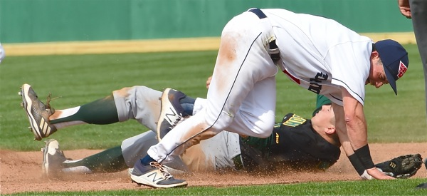 Flyer second baseman Nick Ryan and Mason base runner Logan Driscoll get tangled up in the fourth inning.