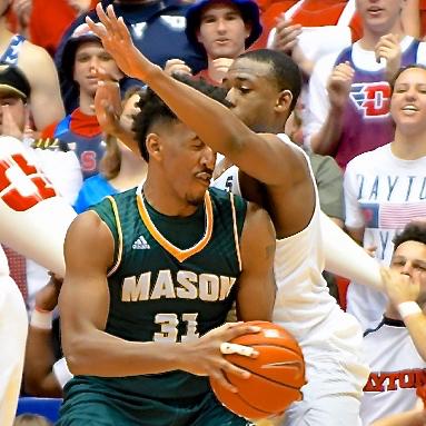 George Mason's Jalen Jenkins gets an under-arm-full of defense from Kendall Pollard.