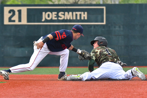 UD's Nick Ryan tags a Wright State runner,  who looks up for the call.