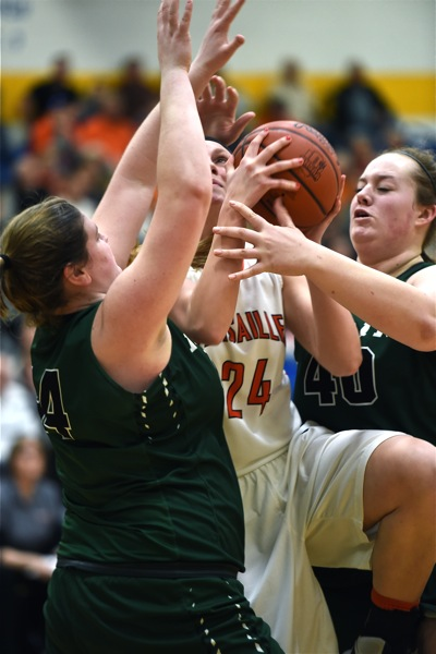 Versailles' Elizabeth Ording fights here way through Broermann (left) and McCurley (right) to score.