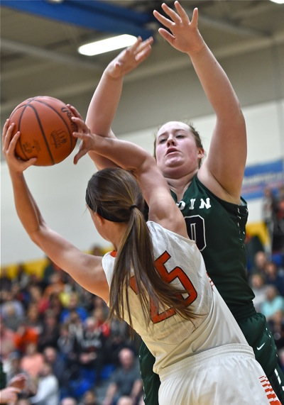 Lindsay Winner against the formidable post presence of Badin's Emma Broermann.