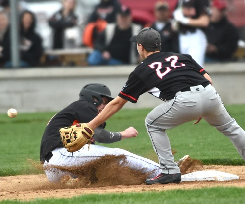 Versailles Noah Grisez steals second in the Tigers' five-run fourth.
