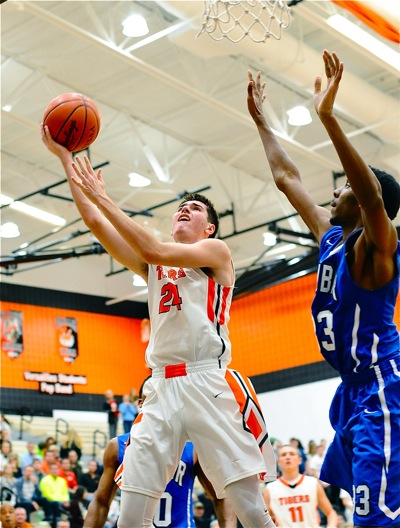 Connor Custenborder sweeps to the rim for two of his eight points.