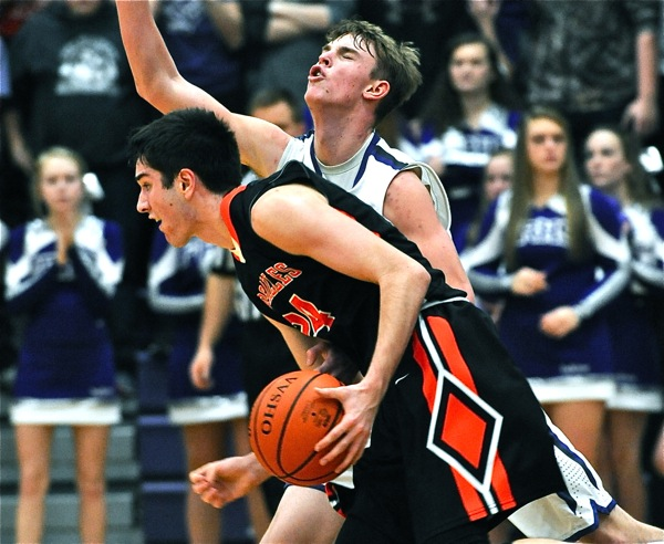 Physical!  Ft. Recovery's Payton Jutte's head snaps back from contact at Versailles' Connor Custenborder drives the lane.