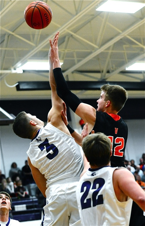 Recovery's Caleb Martin challenges Justin Ahrens at the rim during Friday's first half action.
