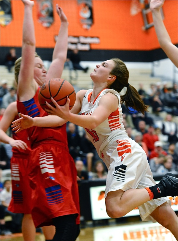 Kami McEldowney slams into a Tri-Village defender on her way to the rim and a pair of first half points.
