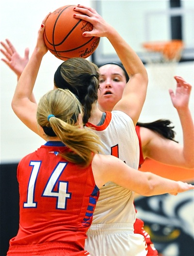 Covering front and back...Versailles' Elizabeth Ording has no place to go against the Patriots' pressure.
