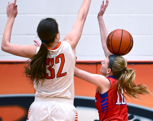 Trick Shot...The Patriots' Allie Downing has a 'heady' moment in Monday's loss to Versailles.
