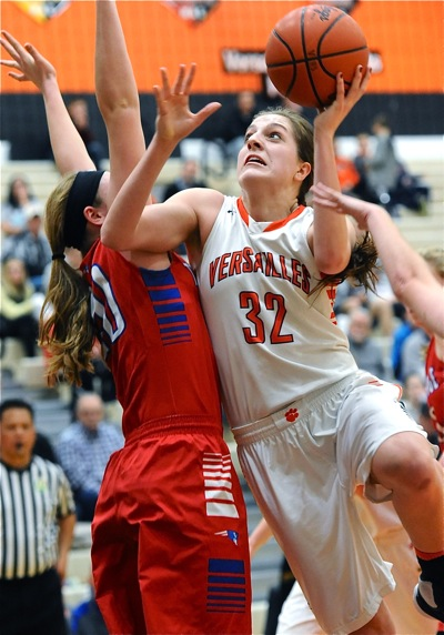 Danielle Winner wheels to the rim against Tri-Village senior Allie Downing.