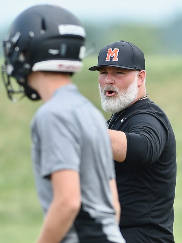Perfect Storm?  Minster's New Coach, And Old Standards