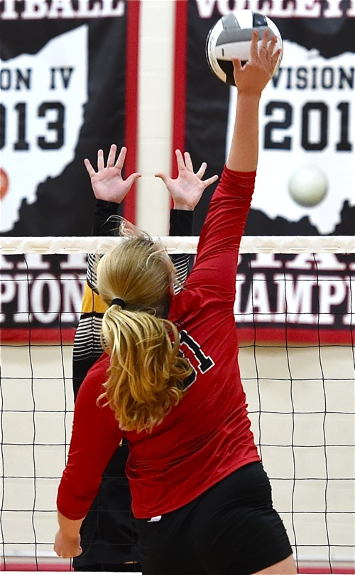 Loramie's Morgan Holscher (#31) hammers down a kill in Tuesday's win over Botkins.