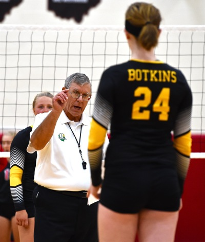 Official Barry Wegman tries to sort things out during a stoppage of play for correcting lineups.
