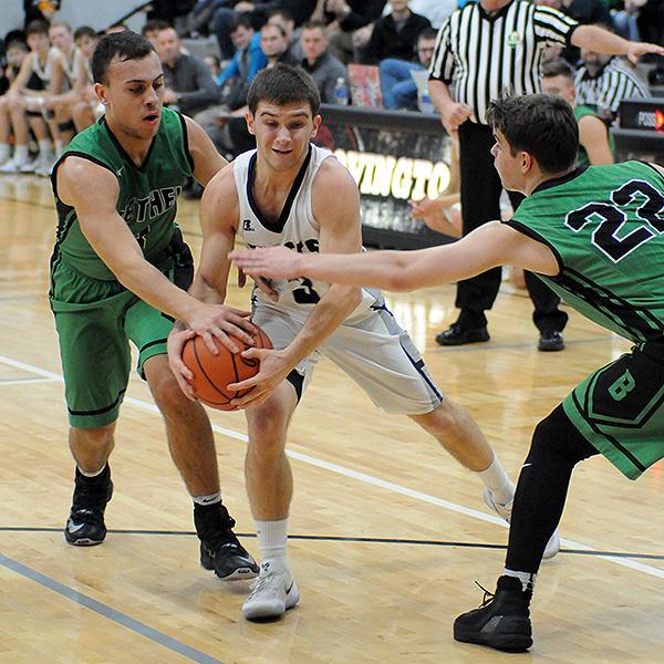 Bethel's Caleb South strips the ball from Covington's Jett Murphy.