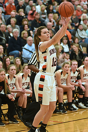 Minster's Hayley Baumer puts up a three-point shot during the Wildcats' 48-42 win over Fort Recovery. (Photo by Dale Barger)